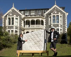 Showing off one of the beds sold to students in Dunedin by The FlatPack are Bryn Fredheim (left)...