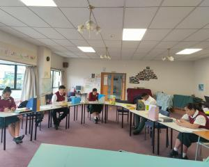 Enjoying being back together for socially distanced study are Amana Christian School pupils (from...