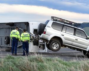 Strong winds blew a caravan over on Mt Cargill Rd yesterday. Photo: Peter McIntosh