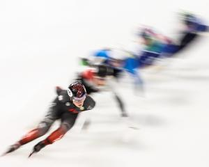 Canadian Kim Boutin leads the pack in the women's 1500m quarterfinals at the short track ice...