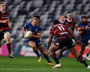 Otago first five-eighth Josh Ioane looks to sidestep Canterbury winger Manasa Mataele during the...
