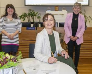 Celeste Donovan signs her Declaration of Office with council chief executive Dawn Baxendale and...