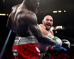Tyson Fury (right) landed a flurry of punches in the 11th round, finally knocking out Deontay...