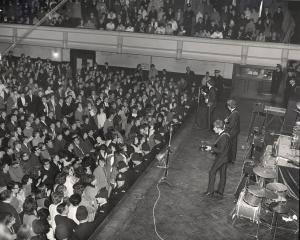 Dunedin Town Hall is filled on June 26, 1964, as the biggest band in the world, The Beatles,...