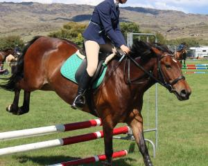 Catherine Guilfoyle (14), of Queenstown, participates in the showjumping competition at the...