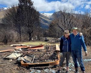 Michael Barker and wife Brigitte Barker at the remains of their family's historic tram, following...