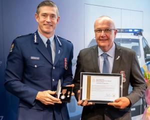 Police Commissioner Andrew Coster presents Olaf Jensen with his meritorious service medal. PHOTO:...