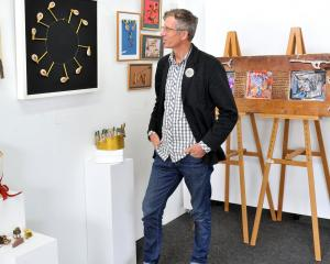 Artsenta director Paul Smith admires the ''Creative Keys'' exhibition at the art studio, in...