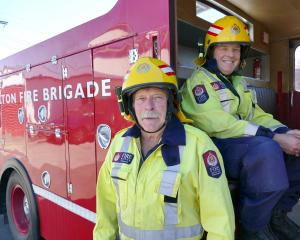 Milton firefighters Alan Tapp (left) and Donald Greene are recent recipients of long-service gold...