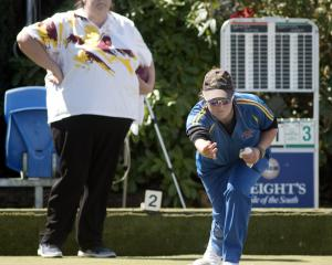 Sarah Scott delivers her bowl as Sandra Keith looks on during the final of the Dunedin Women's...