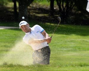 Phil Bungard plays out of a bunker on the fourth hole during the Otago matchplay championship at...