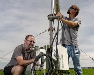 Scientists John Hunt (left) and Scott Graham check the instruments at the field site at Ashley...