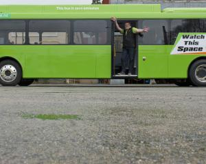Preparing to test an electric bus on Dunedin's hills are (from left) project manager Abbey...