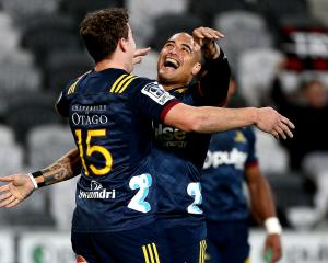 Highlanders co-captain Aaron Smith (right) celebrates with team-mate Josh McKay during a Super...