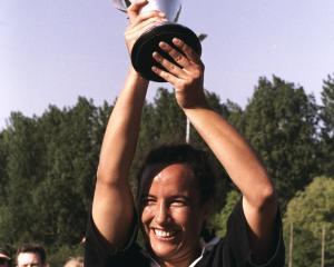 Farah Palmer of New Zealand holds the original trophy aloft after the Womens World Cup final...