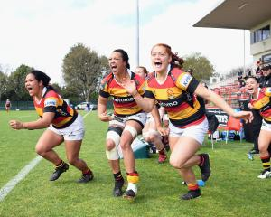 Waikato players celebrate off the bench after winning the Farah Palmer Cup over Canterbury. Photo...