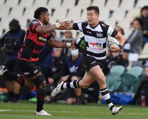 Tiaan Falcon of Hawke's Bay fends off Canterbury's Waisake Naholo in Christchurch. Photo: Getty...