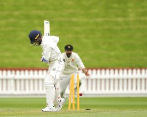 Otago batsman Michael Rippon is bowled by Wellington seamer Nathan Smith during his side's second...