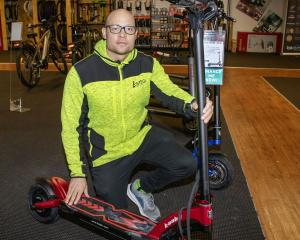 E-Mega Store manager Jeremy Joseph said a dozen e-scooters were taken in the latest theft. Photo:...
