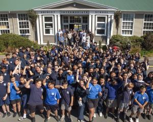 The entire school, staff and pupils lined up for a group shot to mark the last day for the...