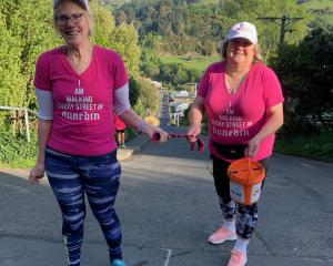 Julie Woods (right) with guide Jo Stodart at the top of Baldwin St this morning. Photo: supplied