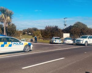 Police at the scene at Karitane where a person was seriously injured. Photo: Craig Baxter