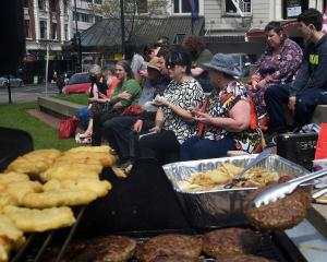 Unions Otago members enjoy a barbecue in the Octagon to celebrate Labour Day. PHOTO: STEPHEN...