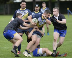 Otago Whalers forward Hagan Free battles West Coast Chargers defenders (from left) Corbin...