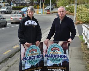 Dunedin Marathon organisers Maria Sleeman and Stu McCormack show off some advertising which will...