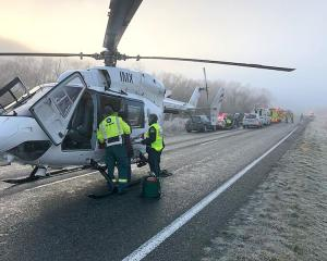 To the rescue  ... A Lakes District Air Rescue Helicopter at the scene of an accident near...