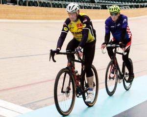 Ray Robinson (front) and Peter Grandiek ride at the ILT Velodrome yesterday. PHOTOS: LUISA GIRAO