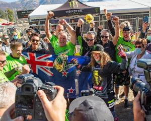 Courtney Duncan celebrates winning her third consecutive FIM Women's Motocross World Championship...