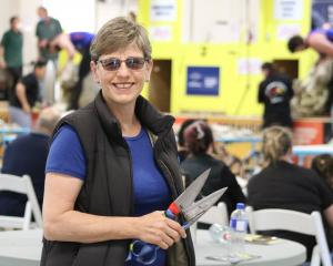 Former women's shearing world record holder Jills Angus Burney is pulling out the blades to...