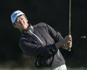 Queenstown's Jerry Song likes the look of his chip on to the 13th green during the Otago regional...