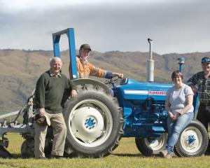 Sime family members (from left) grandfather Jim, grandson Thomas and his parents Jo and Chris at...