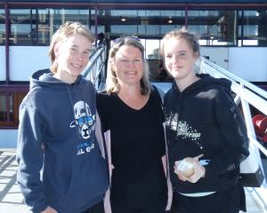 Hayden (12) and Jessica (13) Hodge, with their mother Melanie, received jabs on board TSS...