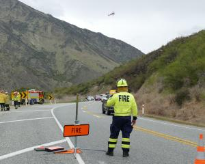 Emergency services near the scene of a fire at Roaring Meg on State Highway 6 today. PHOTO:...