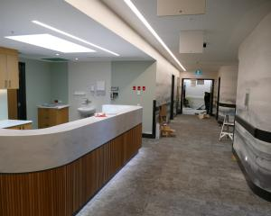 A nurses' station in the hallway leading to inpatient rooms in Southern Cross CLT's new...