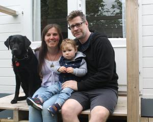 With guide dog Dara by her side, Hannah Pascoe relaxes with son, Max, and partner, Nick Crawford....