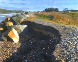 A view of Colac Bay taken from the crumbling coastal road which separates the ocean from an old...