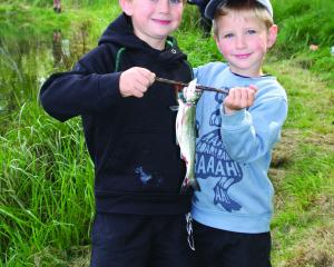 Riverton brothers Conor (5) and Mason (4) McCullough show off their ''catch of the day'' during...