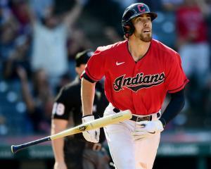 Cleveland Indians centre fielder Bradley Zimmer tosses his bat after hitting a home run off...