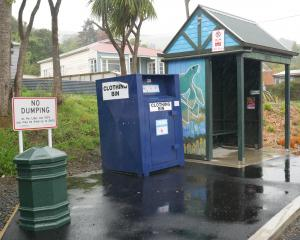 A new ''no dumping'' sign has recently been installed near a Broad Bay clothing bin, which is a...