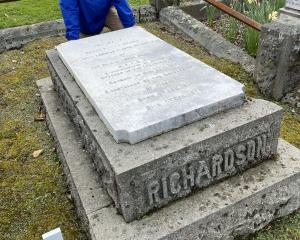 Dunedin military historian Peter Trevathan visits the grave of Major the Honorable Sir John...