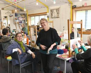 Loom Room owner Christine Keller (seated at left) and tapestry artist Marilyn Rea-Menzies at the...