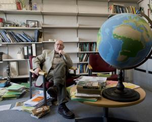 University of Otago geography professor Tony Binns takes a break from clearing his office space...