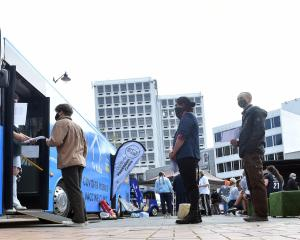 People queue for the vaccine bus in the Octagon in Dunedin. PHOTO: PETER MCINTOSH