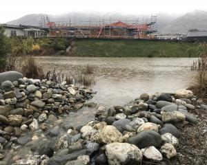 Water overflows from the Alpha Series One stormwater pond into the Otago Fish & Game wetlands...