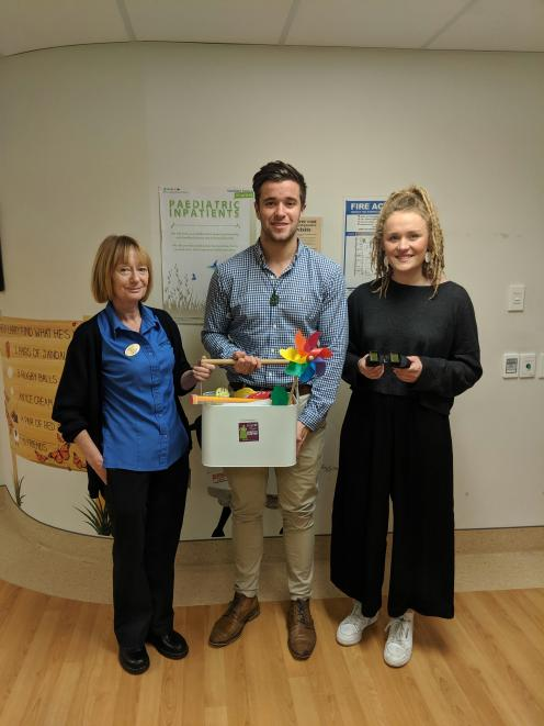Charge nurse manager Shirley Bell (L), and Starlit Hope volunteers Tom Devine (Gabby's Cousin)...