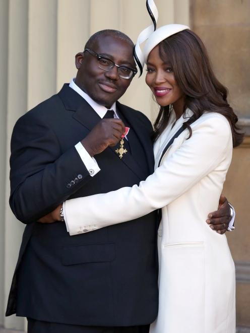 Edward Enniful with model Naomi Campbell after receiving his OBE. Photo: Reuters